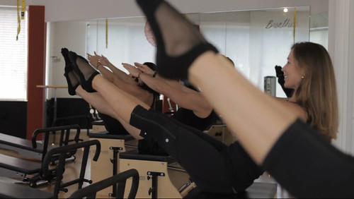 Everyone-in-a-V-pose-on-the-Stott-Pilates-chair