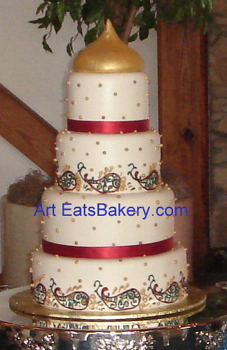 Four tier ivory fondant wedding cake with varied gold, and