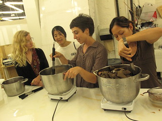 a AP Caption Isa Rodrigues (center) teaches a dyeing class at the Brooklyn chapter of Sewing Rebellion