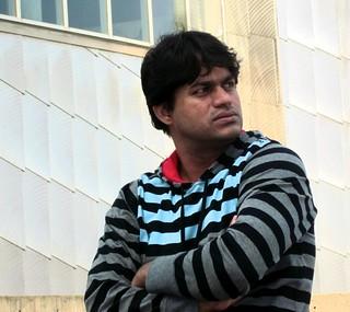 Dark Man in striped hoodie