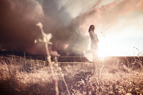 light sunset portrait sky mountain storm mountains texture nature girl field grass clouds standing landscape person solitude horizon perspective dramatic thinking land