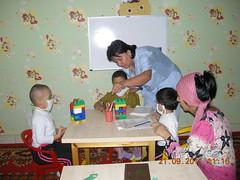 children in hospital`s game room with educator (uzbekistan)