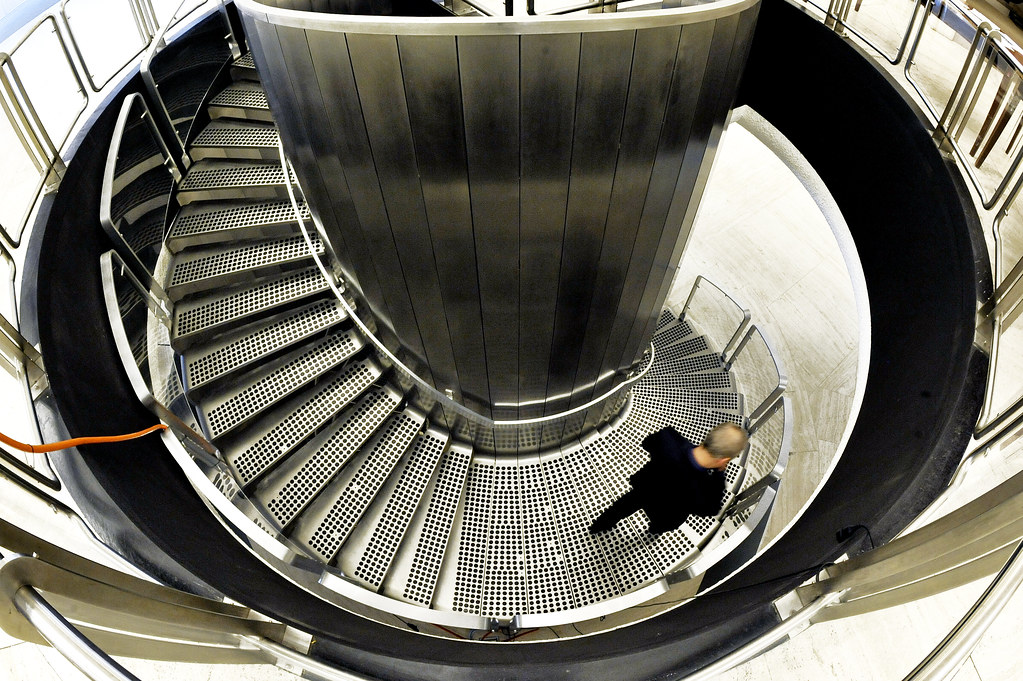 Miraculous Staircase At Geneva Headquarters A Delegate Walks Down A F Home Interior And Landscaping Ponolsignezvosmurscom