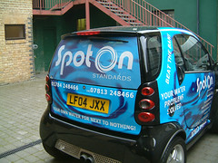 Wrapped car with perforated window graphic