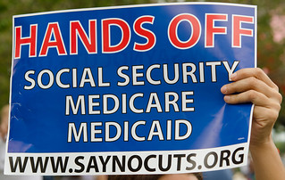 Sign: Hands Off Social Security Medicare Medicaid www.saynocuts.org | by Fifth World Art