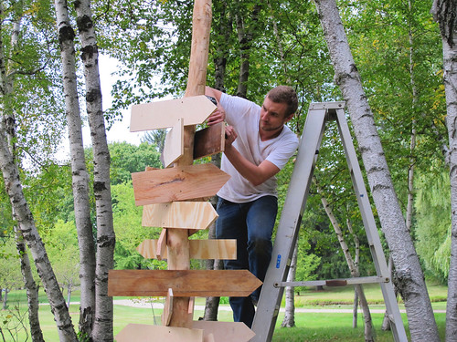 Alec Regan works on David Robbins's Open-Air Writing Desk at Lynden Sculpture Garden. (photo is by David Robbins.)