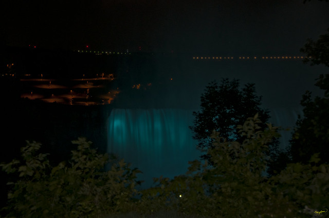 Niagara Falls -the American Falls illuminated by night - view from Pedestrian walkway on the Canadian side