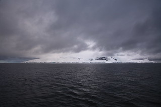 Low, grey clouds in the Gerlache Strait, Antarctica | by Liam Quinn