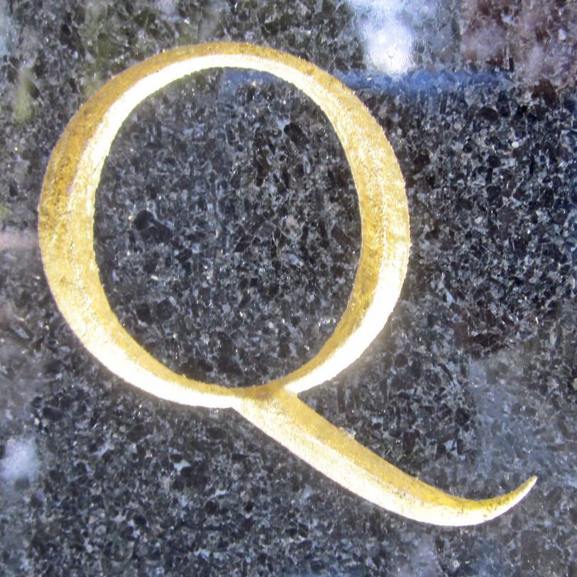 Q gold on black granite