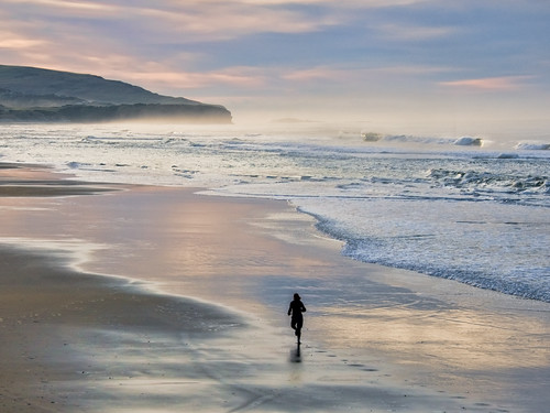 ocean sun beach sunrise bravo waves pacific stclair head south nz otago dunedin lawyers aotearoa jogger glint