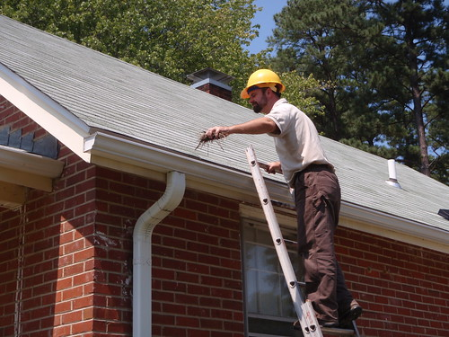 Cyrus Brame cleaning gutters | by U. S. Fish and Wildlife Service - Northeast Region