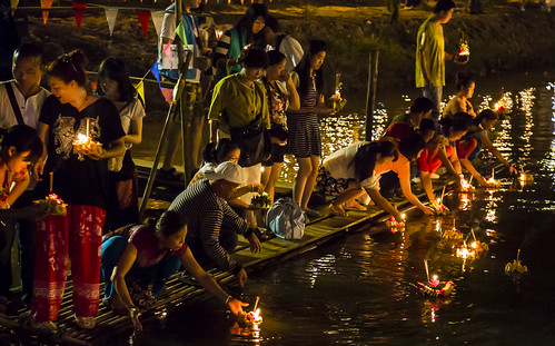 Thai people setting their candle-lit krathongs in the Ping river at night during Loy Krathong 2015-91 | by John Shedrick
