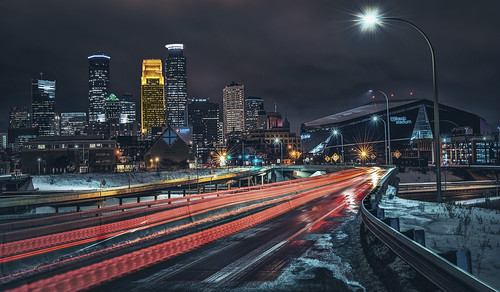 minneapolis downtown cold winter night skyline vikings football stadium usbank mn minnesota longexposure red car cartrails lights city cityscape buildings