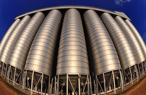 katy katytexas brookshire brookshiretexas wallercounty wallercountytexas ricedryer ricesilo rice silos silversilos reflectivesilos fisheye farming texas sunset dusk