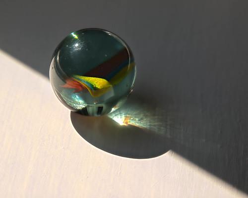 light shadow stilllife sunlight abstract fall glass dark ma toy massachusetts naturallight diagonal sphere swirl marble hdr chelmsford 2011
