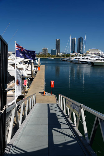 blue sky water architecture buildings reflections boats ramp shadows view flag jetty australia scene queensland yachts surfersparadise goldcoast launches marinamirage triptoqueenslandbrisbane