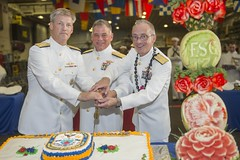 Vice Adm. Robert L. Thomas Jr., left,, commander of U.S 7th Fleet; Rear Adm. John Nowell, middle, commander Expeditionary Strike Group (ESG) 7; and Rear Adm. Hugh D. Wetherald cut the cake at the ESG 7 change of command ceremony. (U.S. Navy/MC3 Taylor A. Elberg)