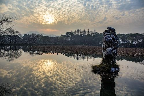hangzhou west lake longjing three pools mirroring moon china sunset