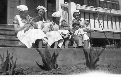 Nurses (?) with babies