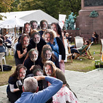 Press shot   Book Festival staff have fun posing as Alasdair Gray look alikes for a press photographer