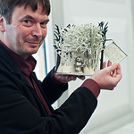 Ian Rankin with book sculpture | Ian Rankin poses with one of the lovely book sculptures left on the Book Festival site