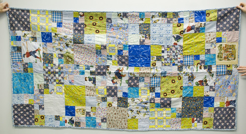 This quilt was my main intention: a twin-sized quilt that E. could use throughout his childhood.   This set of two quilts was for Annie, a co-worker of mine at the library. The main sentimental part of the quilt is the star fabric, which came from a shirt of her mother's. Her mother, Helen, was a co-worker of mine as well until she died of cancer not too long before Annie's son was born.   His grandmother would have ADORED him, and this way, he has a bit of her life in his quilt.  I had one more large square piece of the star fabric, so I decided to do a baby quilt, too.