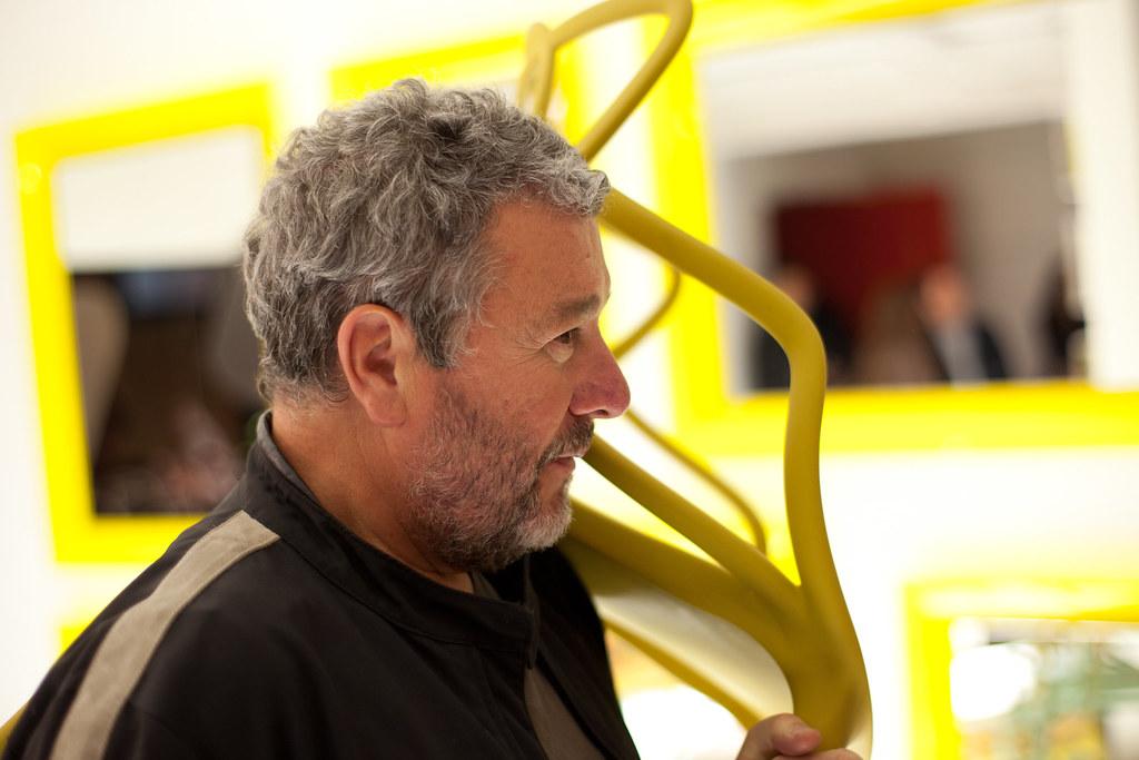 Philippe Starck, Designer holding a Kartell's Chair | 111116-3824-jikatu