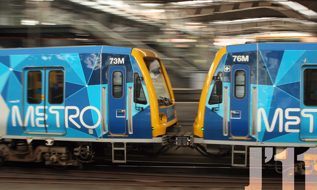 73M-76M depart Southern Cross Station.  Both cars carry re-assigned Motor car numbers, previously used on Hitachis ~01.11.11 by James 460