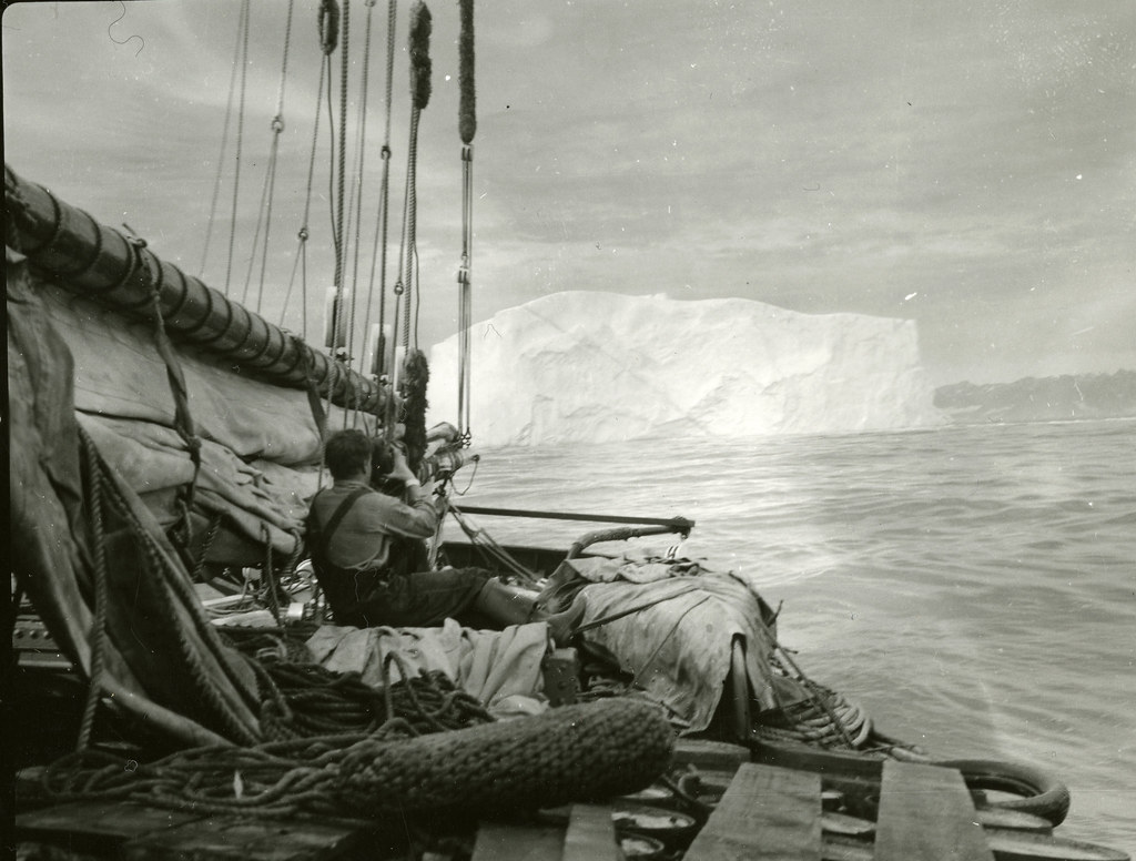 No. 47. Crew member taking a movie of ice berg from the ship, Greenland, 1939
