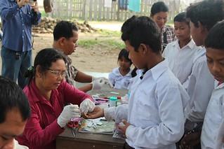 VMW was performing malaria blood test for students during malaria week activities conducted in Pursat 2014_Credit Sam Sokharun, CAP-Malaria_Cambodia