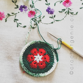 Crocheting some holiday coasters with African Flowers