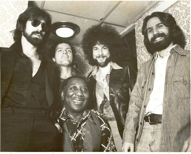 Muddy Waters 60th Birthday party/Jam session at Paul's Mall in Boston April 1975. Left to right Peter Wolf, Al Perry, Muddy Waters, Magic Dick, Dick Wingate