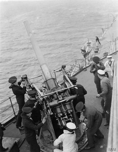 A 3 inch anti-aircraft gun in action on board the battleship HMS Royal Oak.