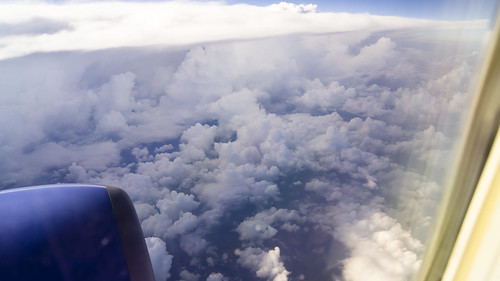 plane fromaplane clousds theair overamerica