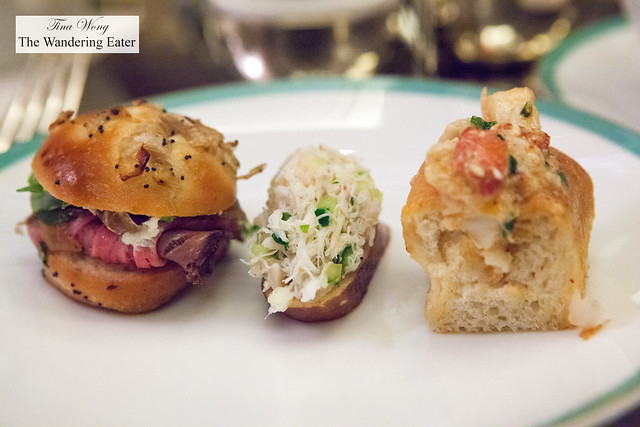 Left to Right: Thyme roasted prime rib sandwich, Peekytoe crab salad crostini, and lobster roll with daikon sprouts in buttered brioche roll