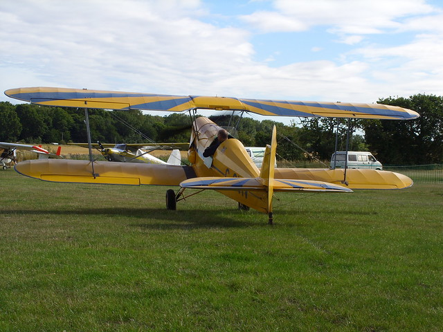 TIGER MOTH BI-PLANE DAMYNS HALL AERODROME  MILITARY CAR AN AIR SHOW IN AN EAST LONDON BOROUGH SUBURB ESSEX ENGLAND IN YELLOW AND BLUE LIVERY  GETTING READY FOR TAKE OF SS854402  9-8-2015