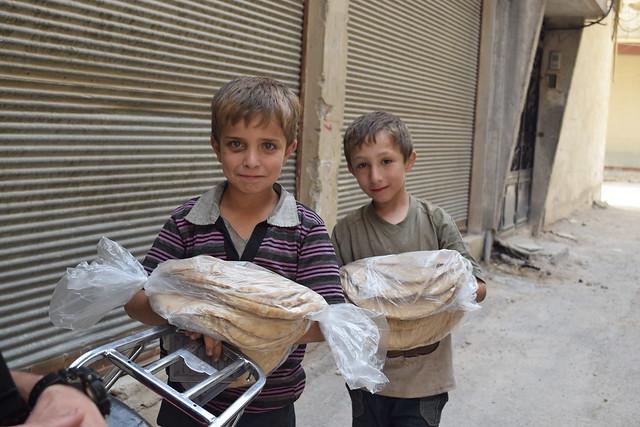 Children in Besieged Ghouta receiving free bread (summer 2015)