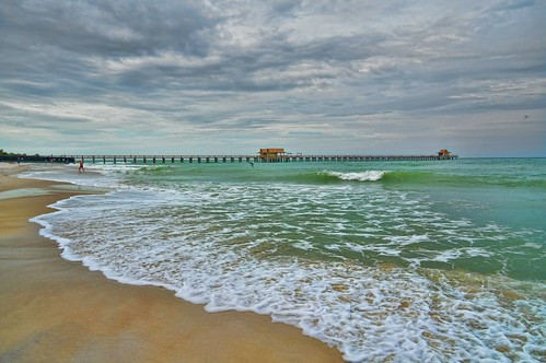 pier closed florida naples naplesbeach paddleboarder naplesfishingpier sfi2015 naplescitybeach