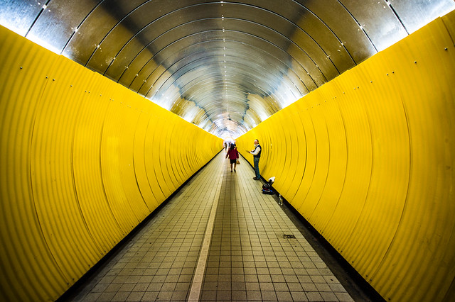 Within the yellow pipe