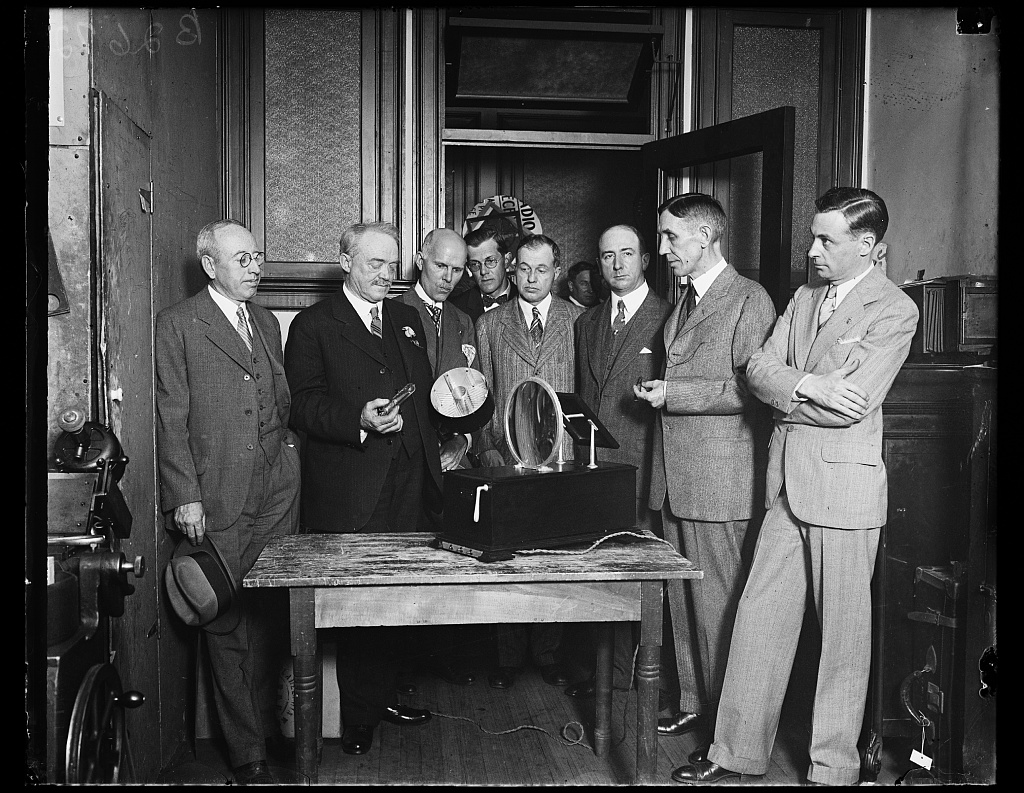 Identified! [Group. Charles Francis Jenkins (2nd from left) showing his Mirror Drum Television Receiver] (LOC)