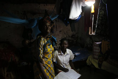 Hadija and her daughter, using an Ensol solar lighting kit in northern Tanzania | by DFID - UK Department for International Development
