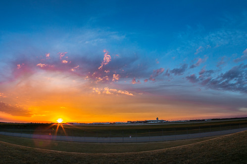 sunnyday sunset airportsunset michigansunset airport geraldrfordinternationalairport geraldrford cloudy clouds michigan westmichigan sun canonphotography canon canon5dmarkiii canonworldwide panoramic