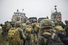 Armed Forces of the Philippines service members board a landing craft air cushion (LCAC) in Palawan, Philippines, during PHIBLEX. (u.S. Navy/MC2 Will Gaskill)