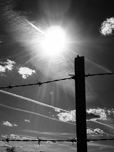 sky blackandwhite bw sun oklahoma clouds fence skyscape landscape wire post sharp cumulus barbedwire rays poles streaks sunrays barbed skiatook