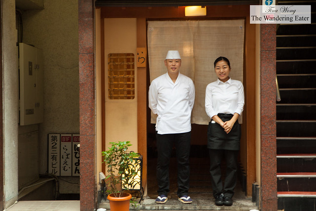 Chef-Owner Hisayoshi Iwa and waitress of the restaurant bidding us farewell from their restaurant