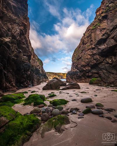 sky cliff seaweed beach clouds nikon rocks jersey channelislands d3000
