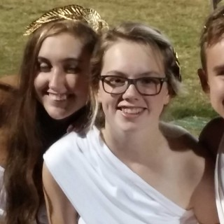 My daughter. In a toga. At a football game. #karma | by lexalexander