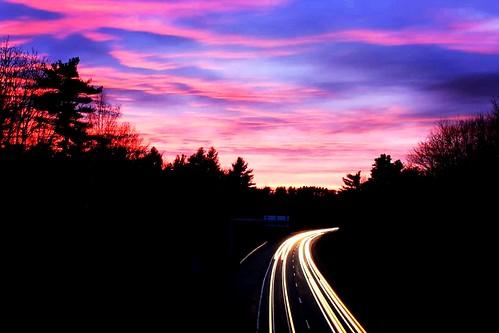 road pink sunset sky clouds lights highway purple dusk