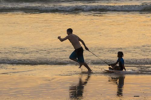 Sunset games at Nai Harn beach, Phuket island, Thailand   by Phuketian.S