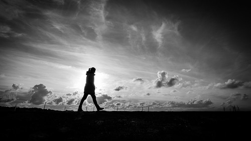 Walking alone - Howth, Ireland - Black and white street photography | by Giuseppe Milo (www.pixael.com)
